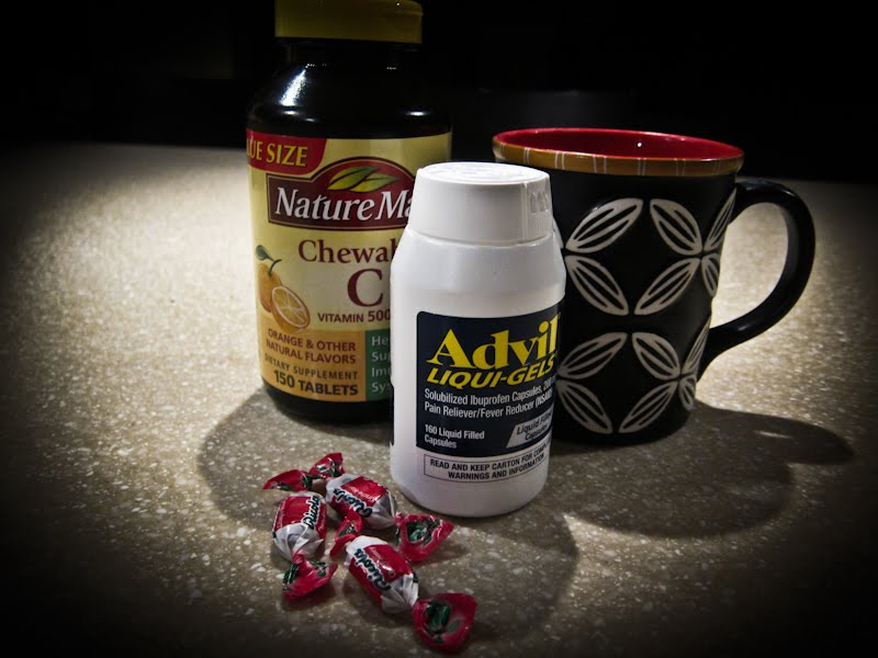 Advil, Vitamin C, Cough drops and tea