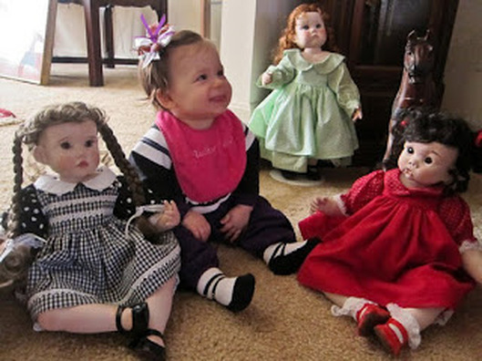 baby with dolls