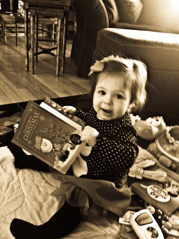 baby Aubree reading